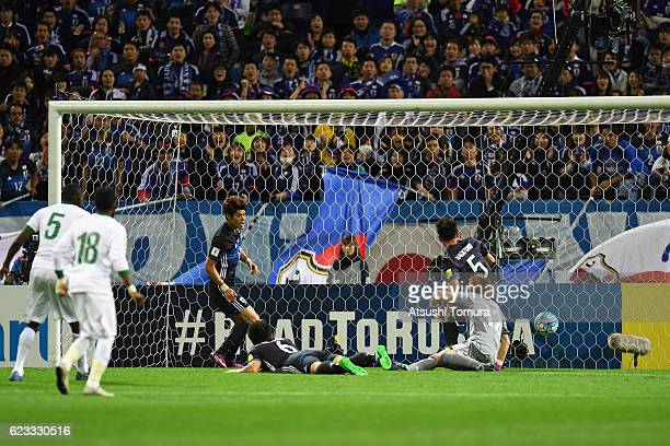 Omar Ibrahim Othman of Saudi Arabia scores his team's first goal during the 2018 FIFA World Cup Qualifier match between Japan and Saudi Arabia at...