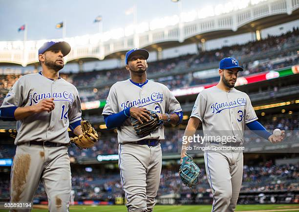 Omar Infante Alcides Escobar and Eric Hosmer of the Kansas City Royals walk off the field during the game between the Kansas City Royals and the New...