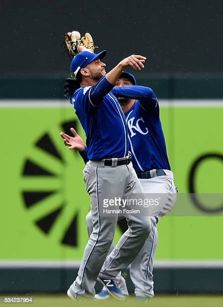 Omar Infante and Paulo Orlando of the Kansas City Royals collide as the ball hit by Eduardo Escobar of the Minnesota Twins is dropped during the...