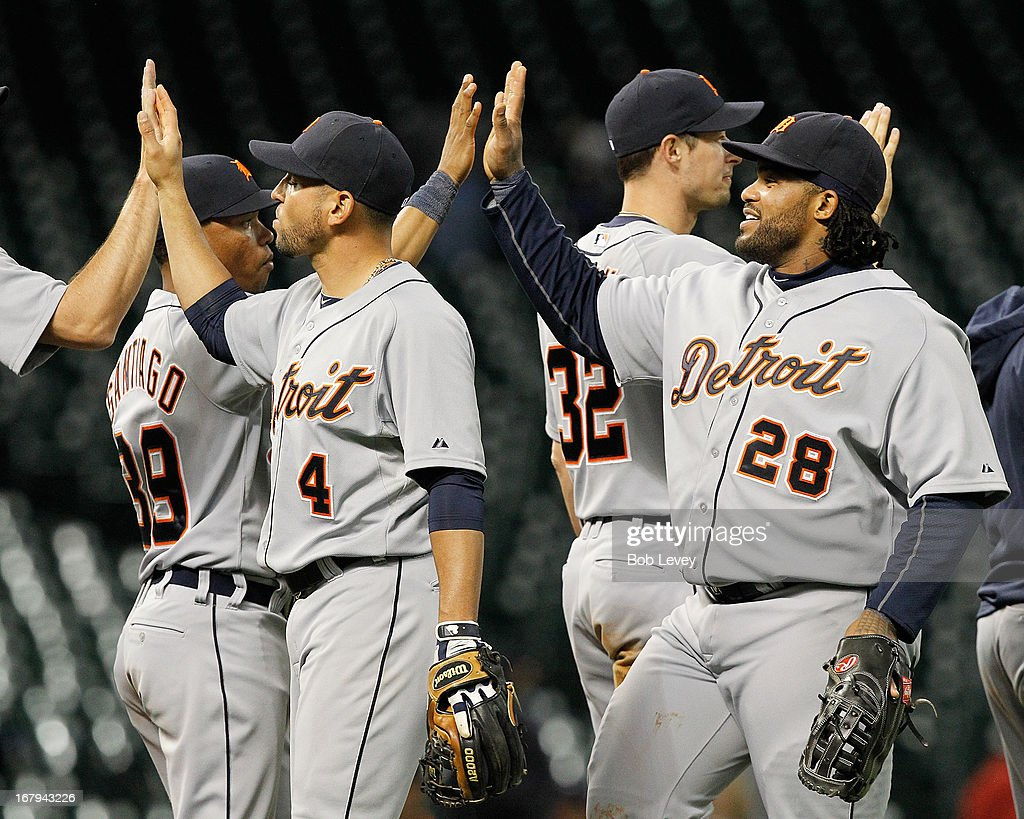 Omar Infante #4 and Prince Fielder #28 of the Detroit Tigers celebrate after defeating the Houston Astros 7-3 in the 14th inning at Minute Maid Park on May 2, 2013 in Houston, Texas.
