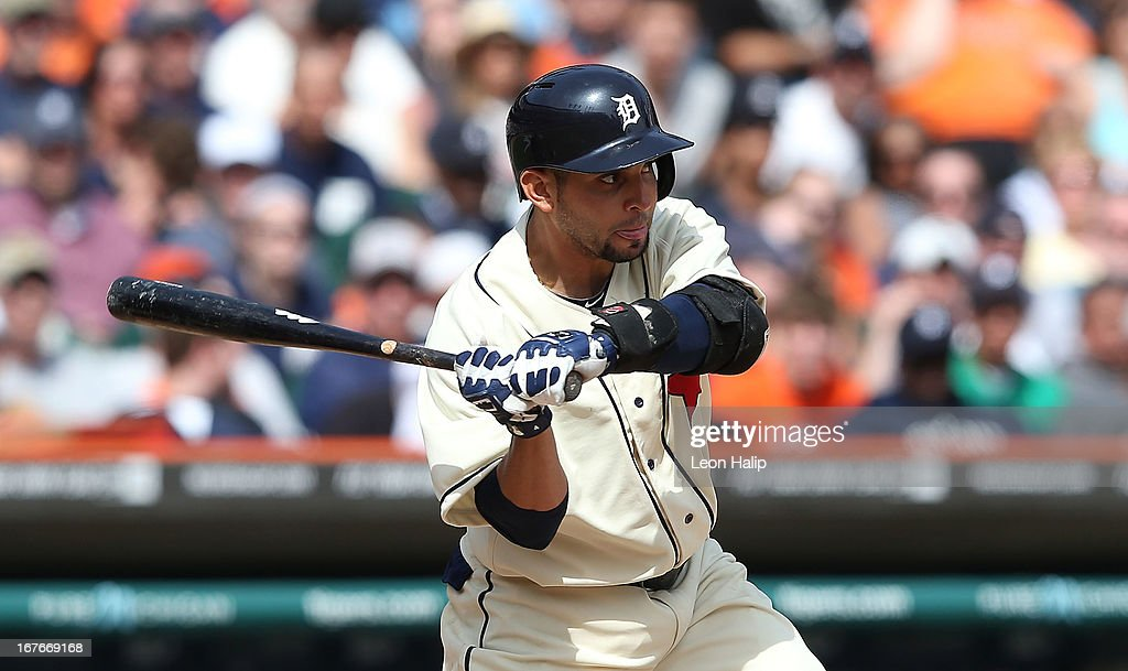 Omar Infante #4 of the Detroit Tigers doubles to left field in the eighth inning scoring Don Kelly #32 during the game against the Atlanta Braves at Comerica Park on April 27, 2013 in Detroit, Michigan. The Tigers defeated the Braves 7-4.