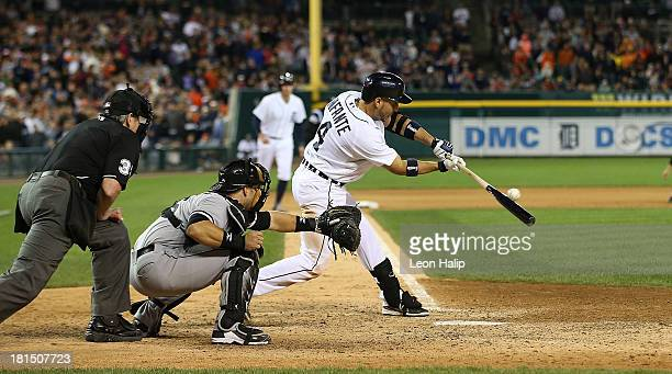 Omar Infante of the Detroit Tigers hits an infield single to win the game in the 12th inning of the game against the Chicago White Sox at Comerica...