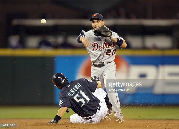 Omar Infante of the Detroit Tigers makes a double play as he tags out Ichiro Suzuki of the Seattle Mariners on July 13, 2007 at Safeco Field in...
