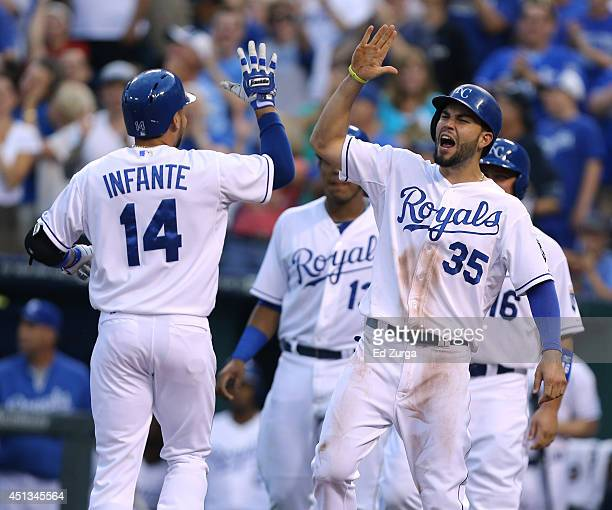 Omar Infante of the Kansas City Royals celebrates his grand slam with Eric Hosmer in the third inning during a game against the Los Angeles Angels of...