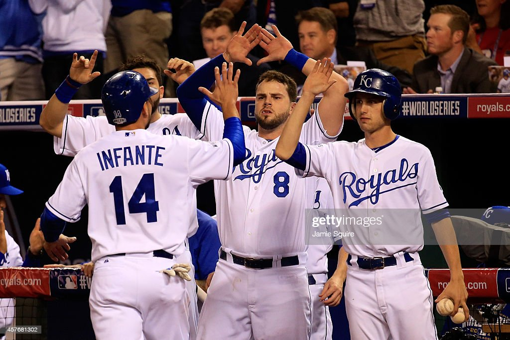 Omar Infante #14 of the Kansas City Royals returns to the dugout after scoring in the second inning against the San Francisco Giants during Game Two of the 2014 World Series at Kauffman Stadium on October 22, 2014 in Kansas City, Missouri.