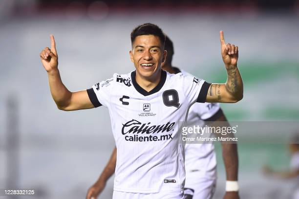 Omar Islas of Queretaro celebrates the third goal of his team by own goal of Luis Garcia of Toluca during the 8th round match between Queretaro and...