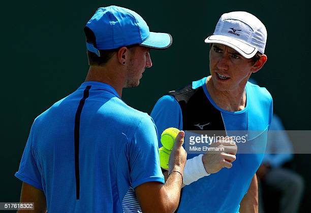 Omar Jasika and JohnPatrick Smith of Australia play a match against Nenad Zimonjic of Serbia and Edauard RogerVasselin of France during Day 6 of the...