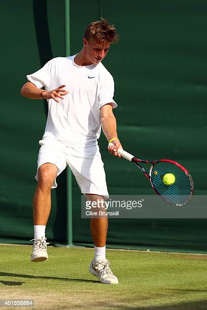 Omar Jasika of Australia during his Boys' Singles first round match against Johan Sebastien Tatlot of France on day eight of the Wimbledon Lawn...