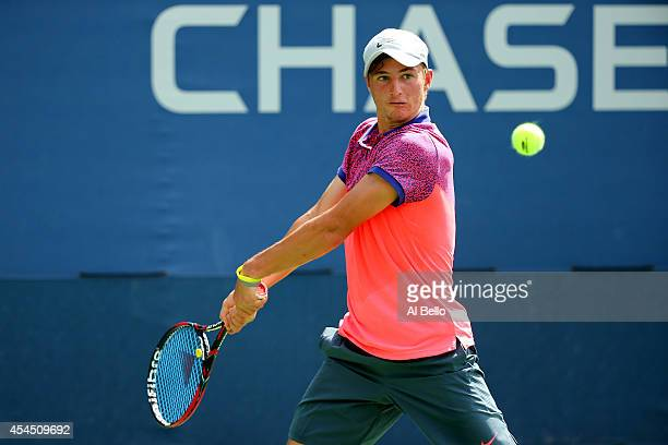 Omar Jasika of Australia in action against Petros Chrysochos of Cyprus during their junior boys' singles second round match on Day Nine of the 2014...