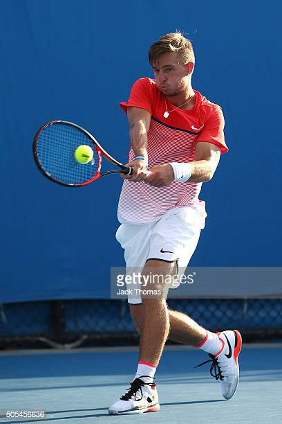 Omar Jasika of Australia plays a backhand in his first round match against Illya Marchenko of the Ukraine during day one of the 2016 Australian Open...
