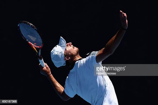 Omar Jasika of Australia serves in his mens singles match against JohnPatick Smith of Australia during the Australian Open December Showdown 2016 at...