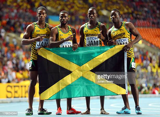 Omar Johnson Edino Steele Javon Francis and Rusheen McDonald of Jamaica celebrate winning silver in the Men's 4x400 metres final during Day Seven of...