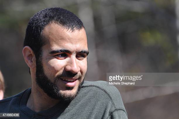 Omar Khadr goes for a walk near the home of Dennis Edney his longtime lawyer on his first day of freedom in nearly 13 years