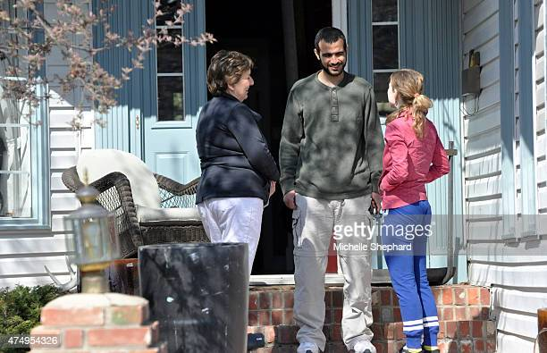 Omar Khadr on May 9 with Patricia Edney wife of Khadr's longtime Canadian lawyer Dennis Edney as a neighbour stops by to wish him well Two days...