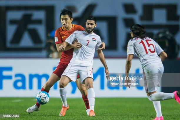 Omar Kharbin of Syria competes for the ball with Feng Xiaoting of China PR during their 2018 FIFA World Cup Russia Final Qualification Round Group A...