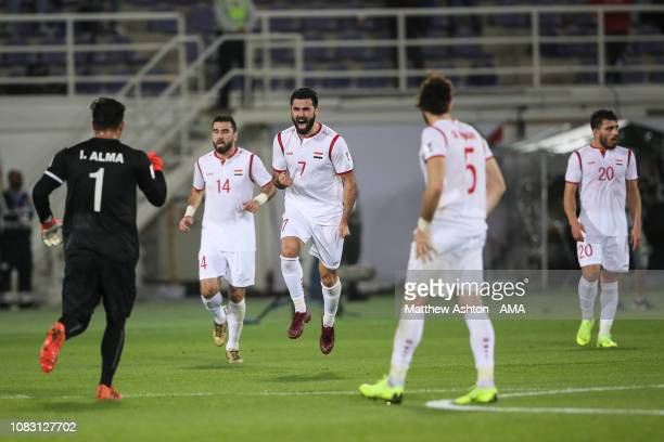 Omar Khrbin of Syria celebrates after scoring a goal to make it 1-1 during the AFC Asian Cup Group B match between Australia and Syria at Khalifa Bin...