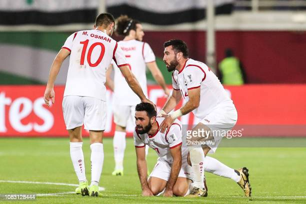 Omar Khrbin of Syria celebrates his scoring during the AFC Asian Cup Group B match between Australia and Syria at Khalifa Bin Zayed Stadium on...