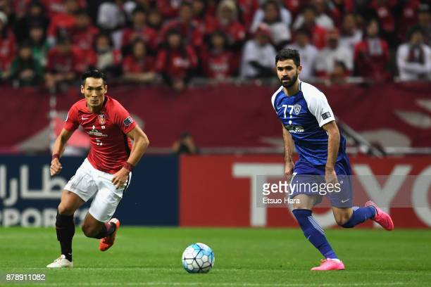 Omar Khribin of AlHilal and Tomoaki Makino of Urawa Red Diamonds compete for the ball during the AFC Champions League Final second leg match between...