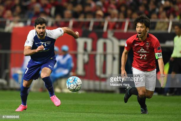 Omar Khribin of AlHilal and Yuki Abe of Urawa Red Diamonds compete for the ball during the AFC Champions League Final second leg match between Urawa...