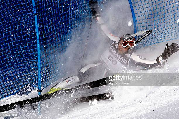 Omar Longhi of Italy crashes during the Alpine FIS World Cup men's giant slalom on February 21, 2009 in Sestriere, Italy.