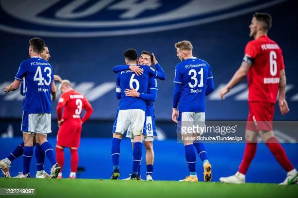Omar Mascarell and Mehmet Aydin of Schalke celebrate their win of the Bundesliga match between FC Schalke 04 and FC Augsburg at Veltins-Arena on...