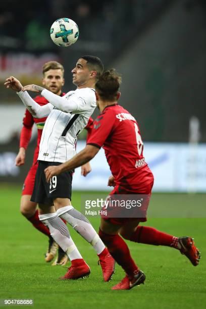 Omar Mascarell of Eintracht Frankfurt and Amir Abrashi of SC Freiburg battle for the ball during the Bundesliga match between Eintracht Frankfurt and...
