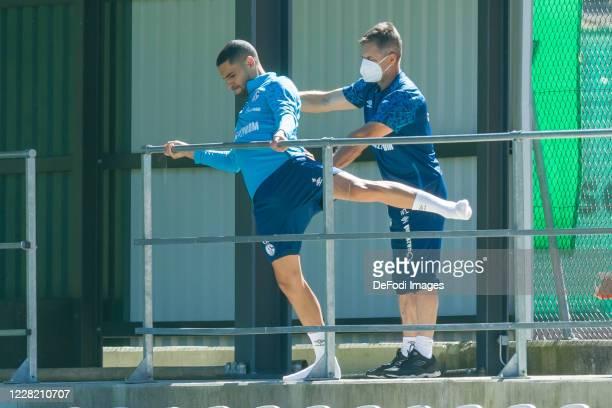 Omar Mascarell of FC Schalke 04 and Athletikhead coach Werner Leuthard of FC Schalke 04 looks on during the FC Schalke 04 Training Camp on August 26,...