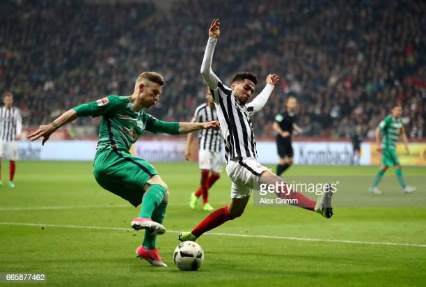Omar Mascarell of Frankfurt and Florian Kains of Bremen battle for the ball during the Bundesliga match between Eintracht Frankfurt and Werder Bremen...