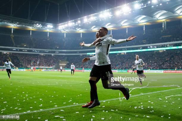 Omar Mascarell of Frankfurt celebrates his team's third goal with team mate Sebastien Haller goal during the DFB Cup quarter final match between...