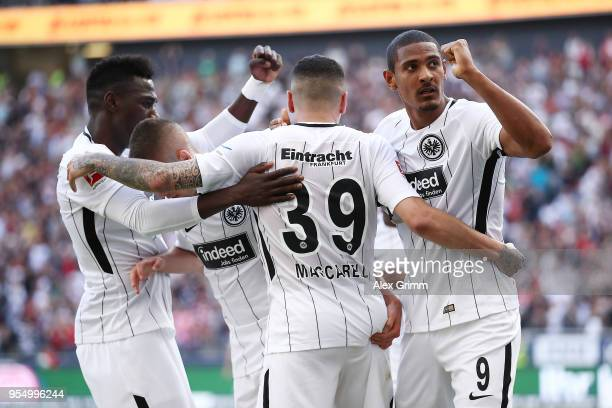 Omar Mascarell of Frankfurt celebrates with his team after he scored a goal to make it 20 during the Bundesliga match between Eintracht Frankfurt and...