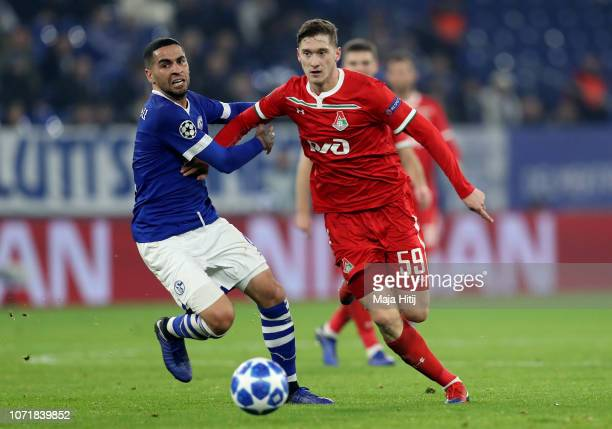 Omar Mascarell of Schalke challenges Aleksei Miranchuk of Moscow during the UEFA Champions League Group D match between FC Schalke 04 and FC...