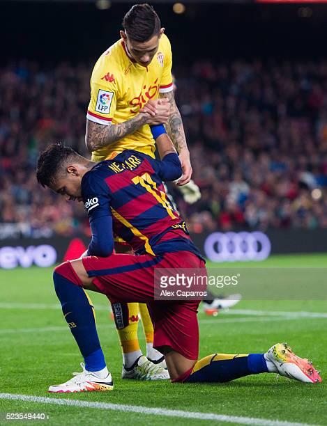 Omar Mascarell of Sporting Gijon helps Neymar Santos Jr of FC Barcelona during the La Liga match between FC Barcelona and Sporting Gijon at Camp Nou...