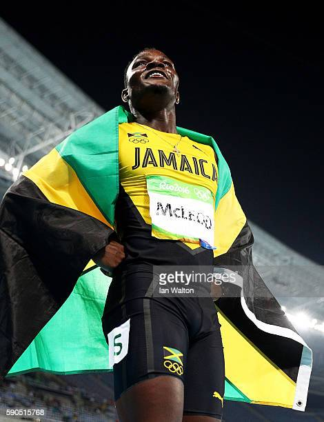 Omar Mcleod of Jamaica celebrates with the flag of Jamaica after winning the gold medal in the Men's 110m Hurdles Final on Day 11 of the Rio 2016...