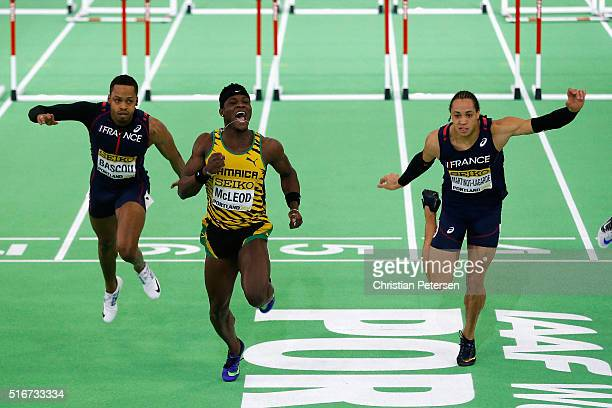 Omar Mcleod of Jamaica crosses the line to win gold ahead of silver medallist Pascal MartinotLagarde of France and bronze medallist Dimitri Bascou of...