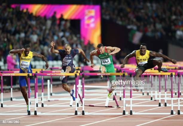 Omar McLeod of Jamaica leads Balazs Baji of Hungary and Garfield Darien of France during the Men's 110 metres hurdles final during day four of the...