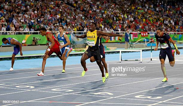 Omar Mcleod of Jamaica wins the gold medal in the Men's 110m Hurdles Final ahead of silver medalist Orlando Ortega of Spain and bronze medalist...
