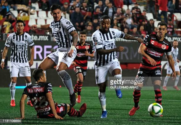 Omar Mendoza and Diego Rodriguez of Tijuana vie for the ball with Adam Bareiro and Dorlan Pabon of Monterrey during their Mexican Clausura 2019...
