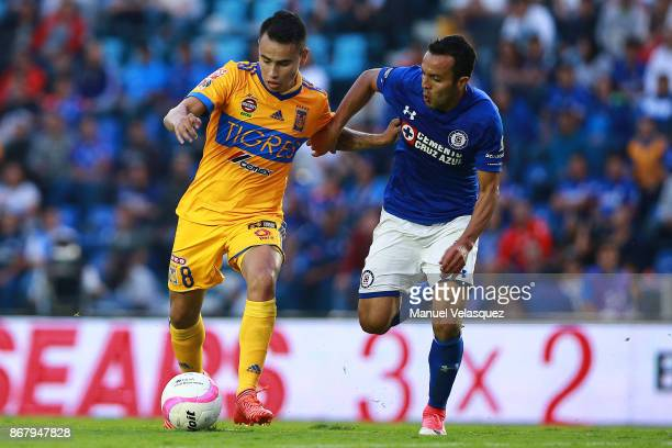 Omar Mendoza of Cruz Azul defends against Lucas Zelarayan of Tigres during the 15th round match between Cruz Azul and Tigres UANL as part of the...