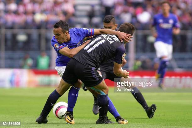 Omar Mendoza of Cruz Azul fights for the ball with Isaac Brizuela and Orbelin Pineda of Chivas during the 2nd round match between Cruz Azul and...