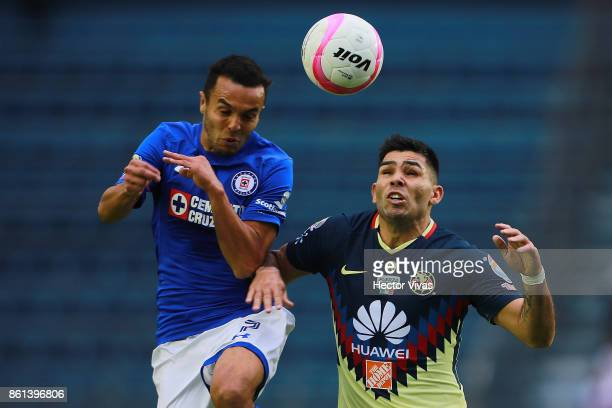 Omar Mendoza of Cruz Azul goes for a header with Silvio Romero of America during the 13th round match between Cruz Azul and America as part of the...
