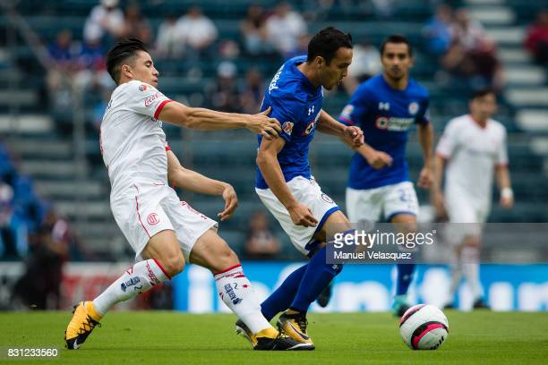 Omar Mendoza of Cruz Azul struggles for the ball against Efrain Velarde of Toluca during the 4th round match between Cruz Azul and Chivas as part of...