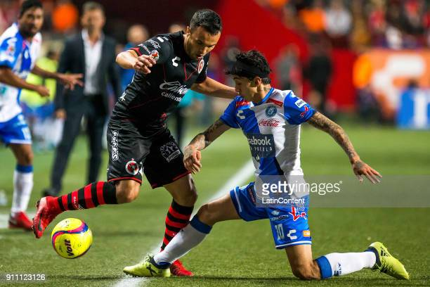 Omar Mendoza of Tijuana and Omar Fernandez of Puebla fight for the ball during the 4th round match between Tijuana and Puebla as part of the Torneo...