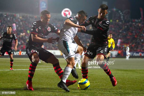 Omar Mendoza of Tijuana Joel Melchor Sanchez of Queretaro and Luis Chavez of Tijuana fight for the ball during the 6th round match between Tijuana...