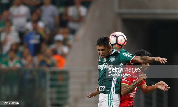 Omar Morales of Bolivia's Jorge Wilstermann jumps to head the ball next to Dudu of Brazil's Palmeiras during their Libertadores Cup football match...