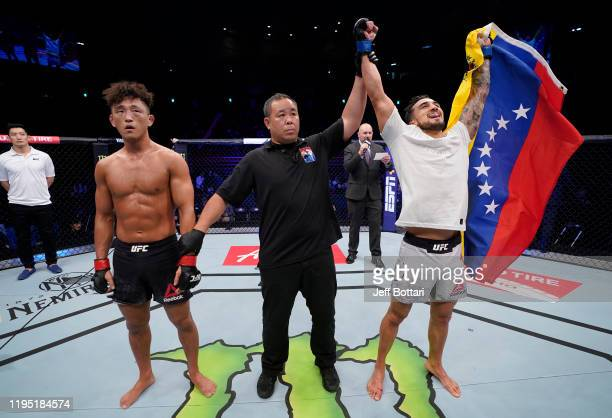 Omar Morales of Venezuela celebrates after his unanimousdecision victory over Dong Hyun Ma of South Korea in their lightweight fight during the UFC...