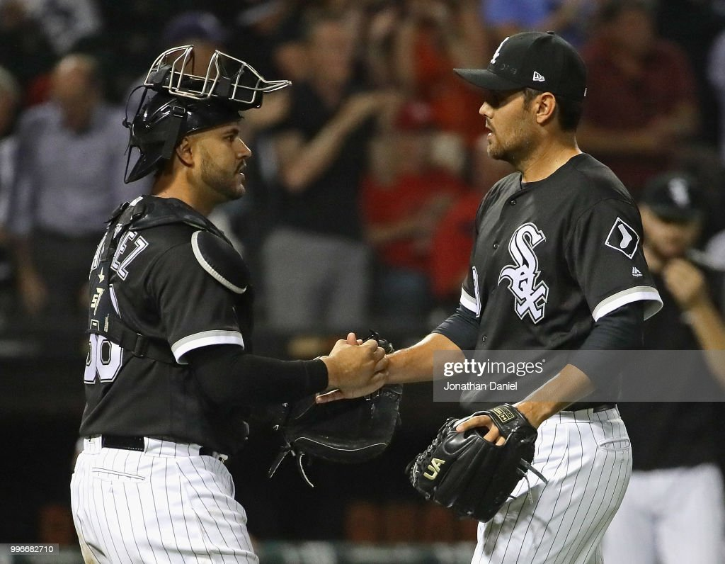 Omar Narvaez #38 (L) and Joakim Soria #48 of the Chicago White Sox shake hands after a win over the St. Louis Cardinals at Guaranteed Rate Field on July 11, 2018 in Chicago, Illinois. The White Sox defeated the Cardinals 4-0.