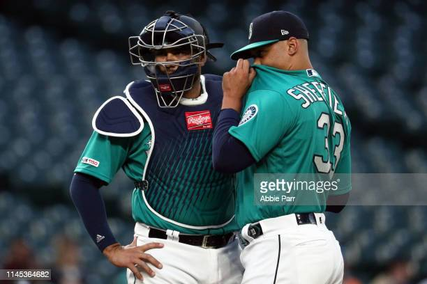 Omar Narvaez and Justus Sheffield have a conversation on the mound against the Texas Rangers during Sheffield's Mariner's debut during their game at...