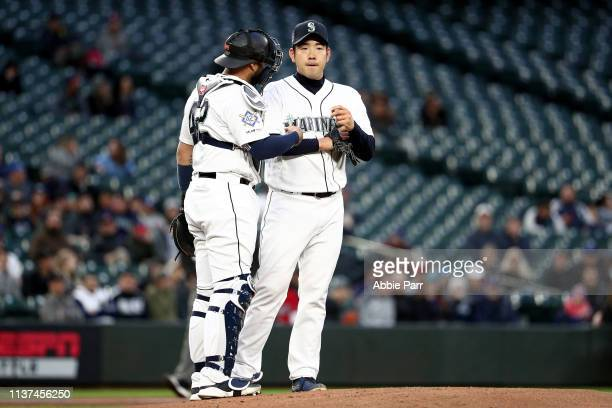 Omar Narvaez and Yusei Kikuchi of the Seattle Mariners discuss play on the mound in the first inning against the Cleveland Indians during their game...