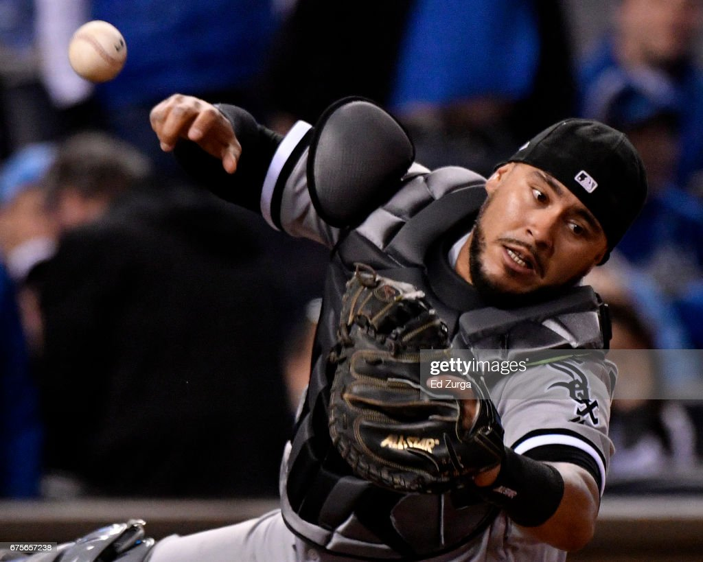 Omar Narvaez #38 of the Chicago White Sox can't catch a foul ball hit by Mike Moustakas #8 of the Kansas City Royals in the seventh inning at Kauffman Stadium on May 1, 2017 in Kansas City, Missouri.