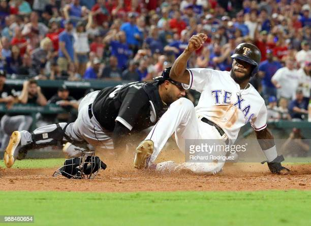 Omar Narvaez of the Chicago White Sox is late with the tag as Delino DeShields of the Texas Rangers scores in the seventh inning of a baseball game...